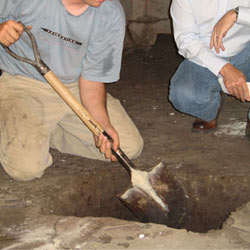 Digging a hole for the engineered fill used in a crawl space support system installation in Dalton