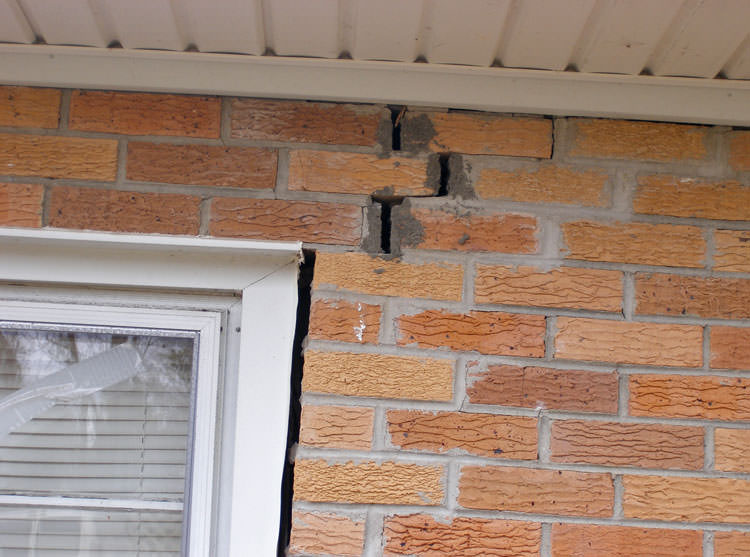 ... A Brick Wall Displaying Stair Step Cracks And Messy Tuckpointing On A  Maryville Home ...