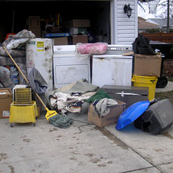 Soaked, wet personal items sitting in a driveway, including a washer and dryer in Oak Ridge.