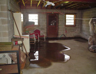 a flooded basement floor in a Crossville home