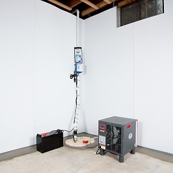 Sump pump system, dehumidifier, and basement wall panels installed during a sump pump installation in Newport