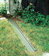 A recessed gutter drain extension installed in Powell, Tennessee and Kentucky